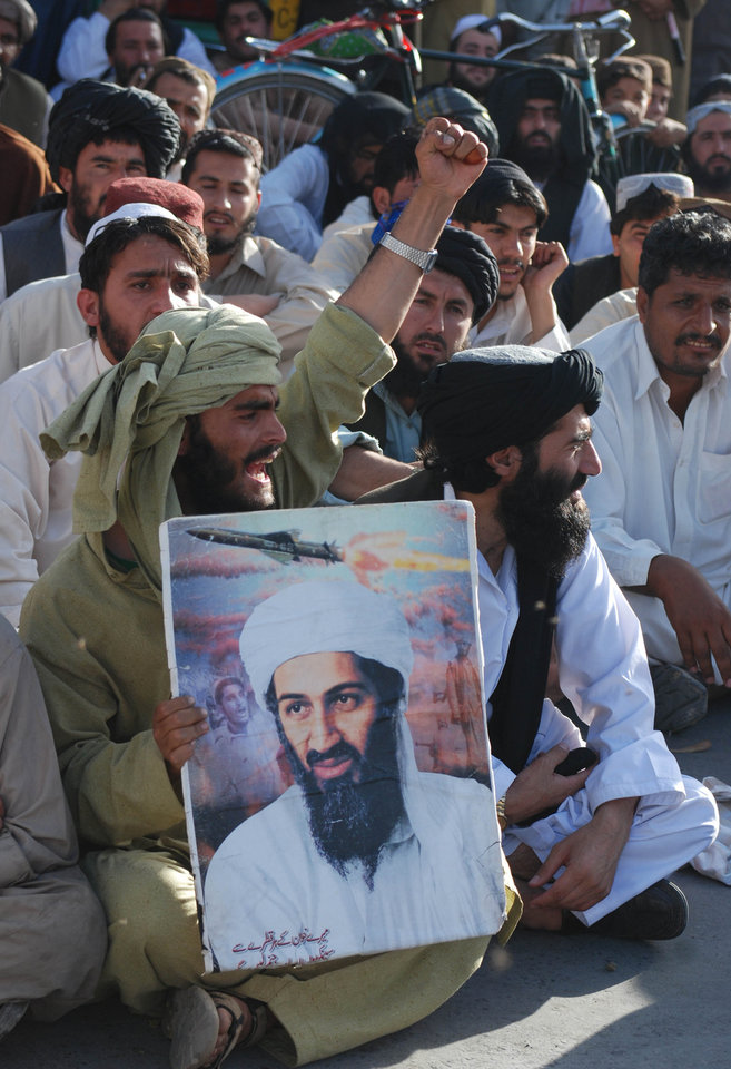 Photo - Supporters of Pakistani religious party Jamiat Ulema-e-Islam rally to condemn killing of Osama bin Laden in Quetta, Pakistan on Monday, May 2, 2011. Osama bin Laden, the mastermind behind the Sept. 11, 2001, terror attacks that killed thousands of people, was slain in his hideout in Pakistan early Monday in a firefight with U.S. forces, ending a manhunt that spanned a frustrating decade. (AP Photo/Arshad Butt) ORG XMIT: QUT105