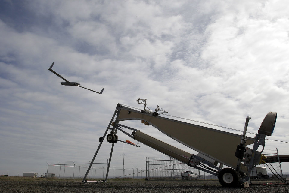 This photo taken March 26, 2013, shows an Insitu ScanEagle unmanned aircraft launched at the airport in Arlington, Ore.  It�s a good bet that in the not-so-distant future aerial drones will be part of Americans� everyday lives, performing countless useful functions. A far cry from the killing machines whose missiles incinerate terrorists, these generally small unmanned aircraft will help farmers more precisely apply water and pesticides to crops, saving money and reducing environmental impacts. They�ll help police departments to find missing people, reconstruct traffic accidents and act as lookouts for SWAT teams. They�ll alert authorities to people stranded on rooftops by hurricanes, and monitor evacuation flows.  (AP Photo/Don Ryan)