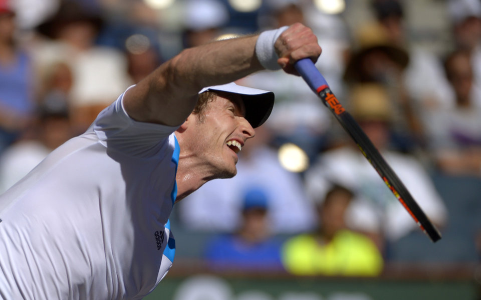 Photo - Andy Murray, of Great Britain, serves to Lukas Rosol, of the Czech Republic, during their match at the BNP Paribas Open tennis tournament, Saturday, March 8, 2014, in Indian Wells, Calif. (AP Photo/Mark J. Terrill)