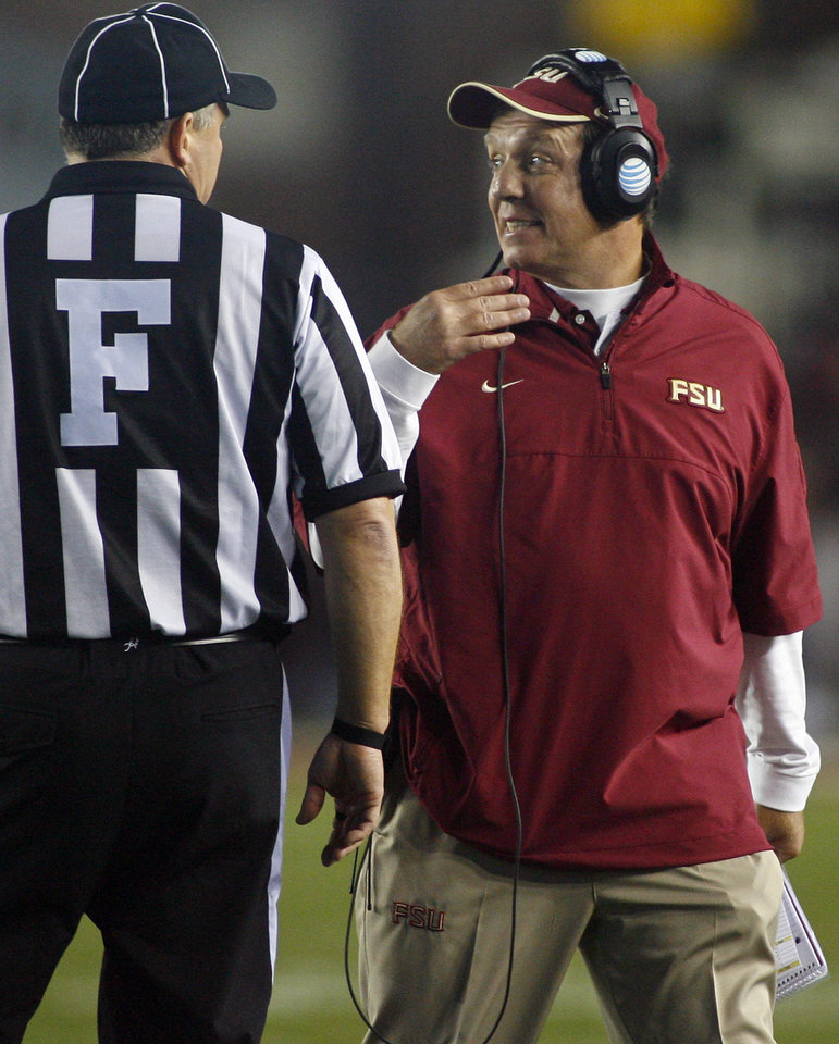 Florida State head coach Jimbo Fisher discusses a penalty with an official during the fourth quarter of an NCAA college football game against Florida on Saturday, Nov. 24, 2012, in Tallahassee, Fla. Florida beat Florida State 37-26. AP Photo/Phil Sears)