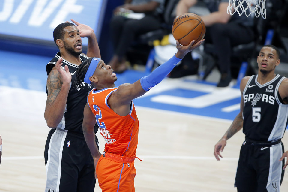 Photo - Oklahoma City's Shai Gilgeous-Alexander (2) goes past San Antonio's LaMarcus Aldridge (12) during an NBA basketball game between the Oklahoma City Thunder and the San Antonio Spurs at Chesapeake Energy Arena in Oklahoma City, Tuesday, Jan. 12, 2021.  San Antonio won 112-102. [Bryan Terry/The Oklahoman]