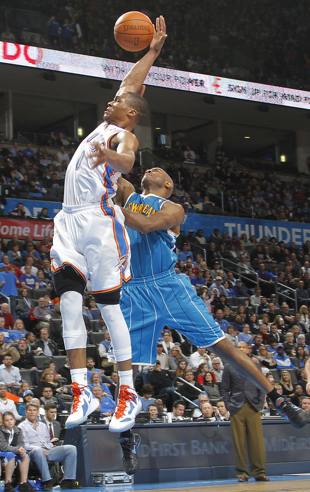 Photo - New Orleans Hornets point guard Jarrett Jack (2) stops Oklahoma City Thunder point guard Russell Westbrook (0) as he drives to the basket during the NBA basketball game between the Oklahoma City Thunder and the New Orleans Hornets at the Chesapeake Energy Arena on Wednesday, Jan. 25, 2012, in Oklahoma City, Okla. Photo by Chris Landsberger, The Oklahoman