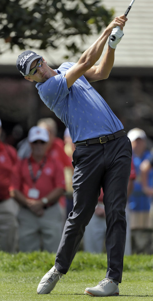 Photo - Adam Scott, of Asutralia, hits his tee shot on the first hole during a pro-am before start of the Arnold Palmer Invitational golf tournament at Bay Hill Wednesday, March 19, 2014, in Orlando, Fla. (AP Photo/Chris O'Meara)
