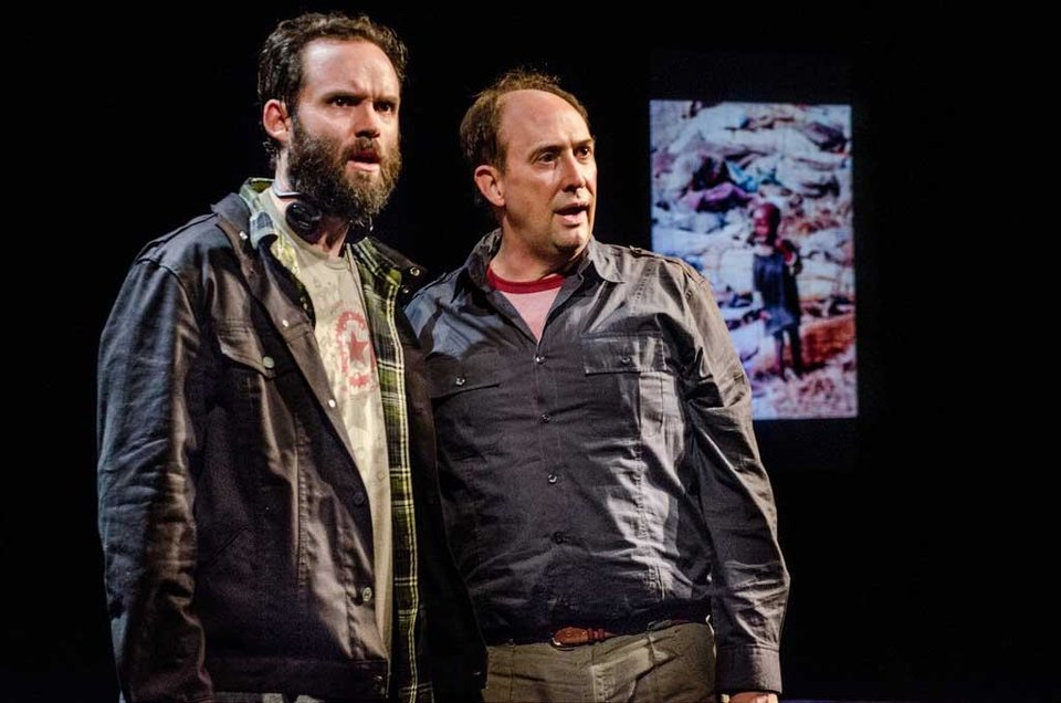 Photo - This theater image released by Portland Center Stage via Columbia University  shows Danny Wolohan as Dan O'Brien, left, and William Salyers as Paul Watson during a performance of
