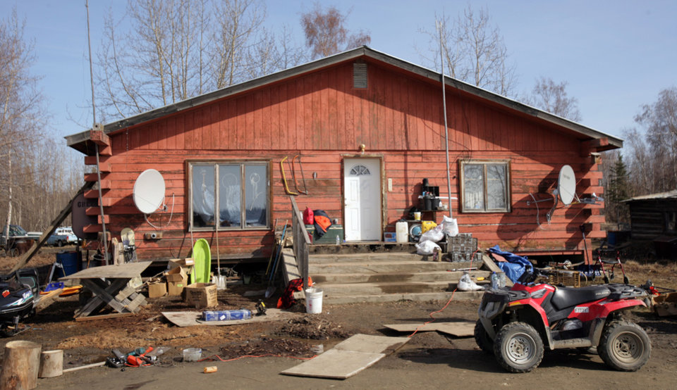Photo - This Friday, May 2, 2014 photo shows the house at the scene of the fatal shooting of Alaska State Trooper Sergeant Patrick