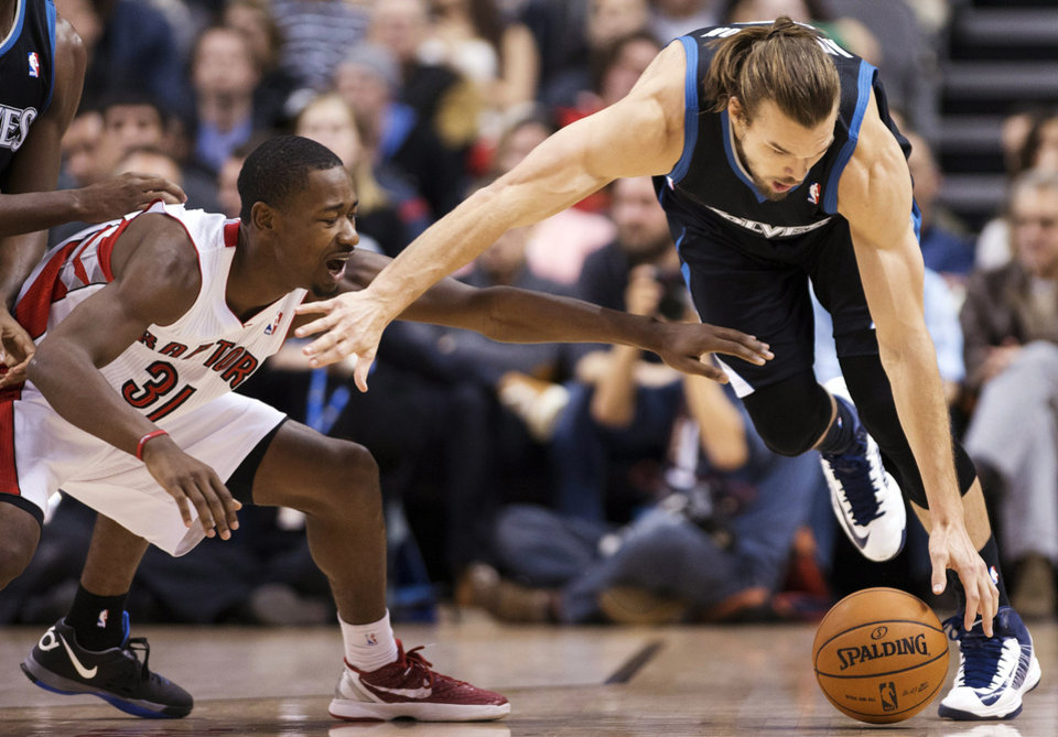 Toronto Raptors forward Terrence Ross, left, battles for the ball against Minnesota Timberwolves forward Lou Amundson, right, during the second half of their NBA basketball game, Sunday, Nov. 4, 2012, in Toronto. The Raptors won 105-86. (AP Photo/The Canadian Press, Nathan Denette)