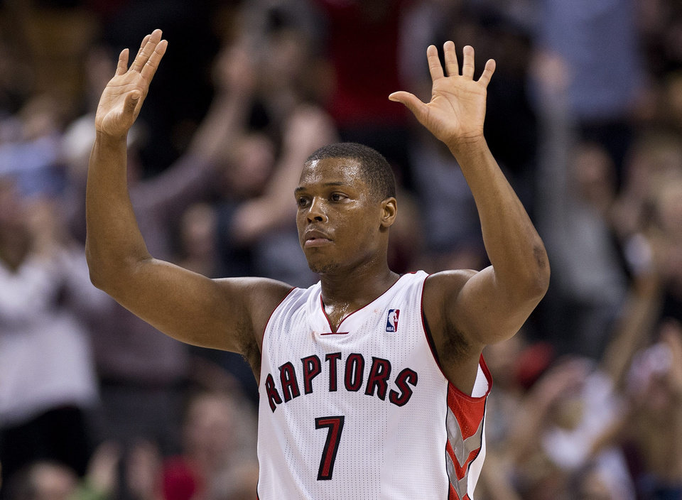 Photo - Toronto Raptors guard Kyle Lowry reacts after hitting a tipple against the Memphis Grizzlies during second half NBA basketball action in Toronto on Friday, March. 14, 2014. (AP Photo/The Canadian Press, Nathan Denette)