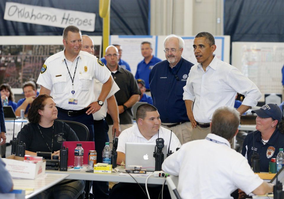 Photo - President Barack Obama greets first responders on May 26, 2013, at Moore Fire Station No. 1 in Moore. [Photo by Bryan Terry, The Oklahoman]