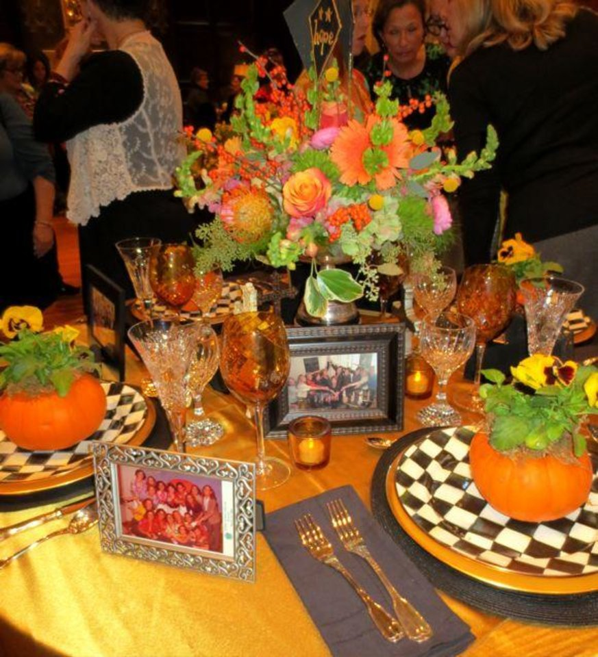 """Theta for a Lifetime"" Table by Susan Ryan, Laura Basden, Madalyn Hawes, Suzanne Holmgren, Debbie Hoose and Teri Hubbard. (Photo by Helen Ford Wallace)."