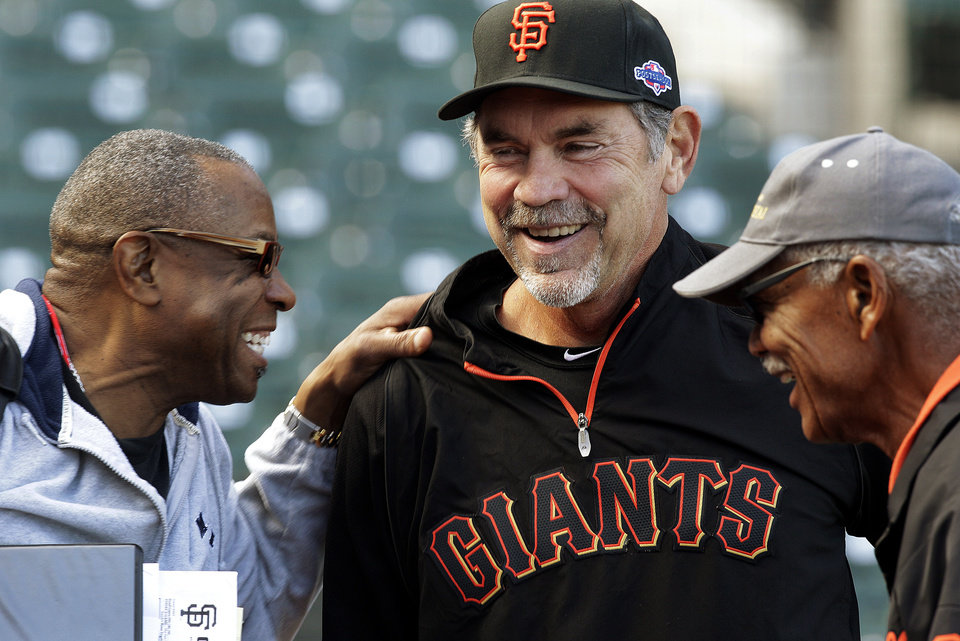 Cincinnati Reds manager Dusty Baker, left, laughs with San Francisco Giants manager Bruce Bochy and special assistant Felipe Alou, right, during batting practice in preparation for Game 1 of the National League division baseball series, Thursday, Oct. 4, 2012, in San Francisco. (AP Photo/Ben Margot)