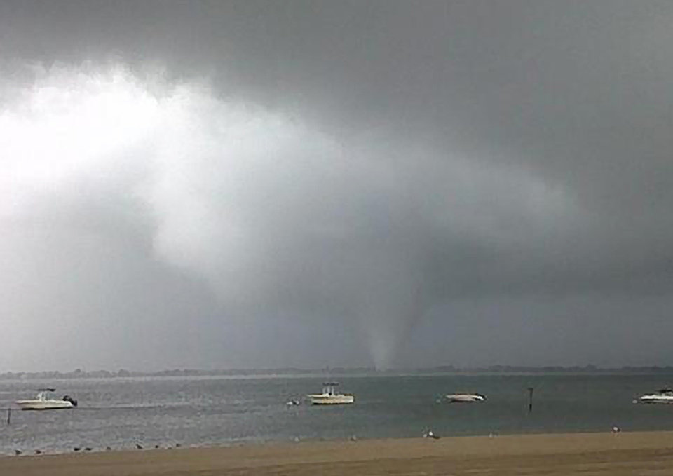 Photo -   This photo provided by Joey Mure, shows a storm cloud over the Breezy Point area of Queens section of New York, on Saturday, Sept. 8, 2012. A Fire Department spokesman said there were power lines down and possibly other damage in the Point Breeze section of the Rockaway peninsula in Queens. The general manager of the Breezy Point Surf Club tells the Associated Press the storm ripped up cabanas and even picked up industrial-sized metal trash bins. The National Weather Service issued a tornado warning for Queens and Brooklyn as a line of strong thunderstorms moved through the city. The service said radar detected a