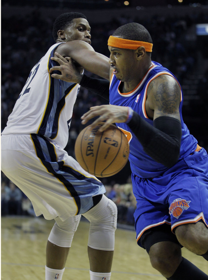 New York Knicks\' Carmelo Anthony, right, pushes Memphis Grizzlies\' Rudy Gay away during the first half of an NBA basketball game in Memphis, Tenn., Friday, Nov. 16, 2012. (AP Photo/Danny Johnston)