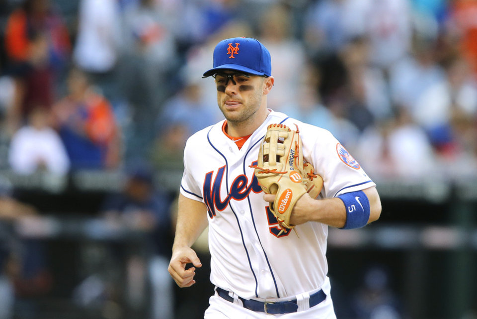 Photo - New York Mets' David Wright returns to the dugout at the middle of the ninth inning of a baseball game against the San Diego Padres, Saturday, June 14, 2014, in New York. San Diego won 5-0. (AP Photo/Jason DeCrow)