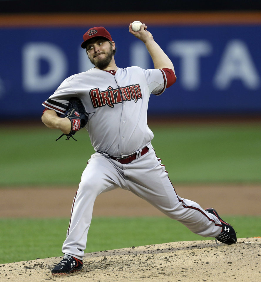 Photo - Arizona Diamondbacks starting pitcher Wade Miley pitches during the first inning of the baseball game against the New York Mets at Citi Field, Monday, July 1, 2013, in New York. (AP Photo/Seth Wenig)