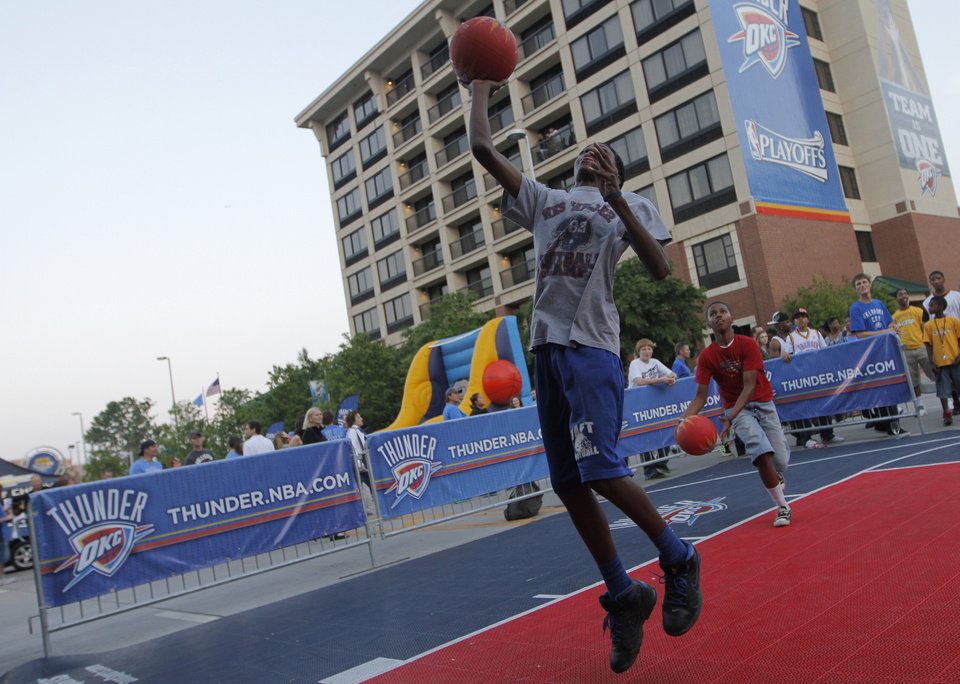 Deonte Howard and Keshawn Williams play basketball at Love's Thunder Alley, Monday, April 30, 2012.  Photo by Garett Fisbeck, For The Oklahoman