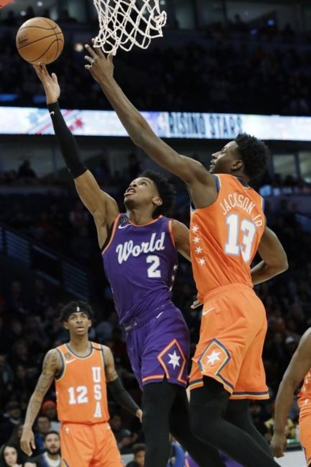 Photo -  Shai Gilgeous-Alexander, left, shoots against Jaren Jackson Jr. during the first half of the NBA Rising Stars game Friday in Chicago. [AP Photo/Nam Y. Huh]