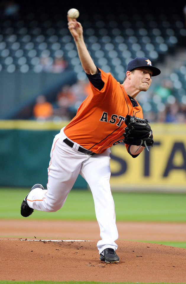 Photo - Houston Astros' Lucas Harrell delivers a pitch in the first inning of a baseball game against the Los Angeles Angels, Friday, April 4, 2014, at Minute Maid Park in Houston. (AP Photo/Eric Christian Smith)