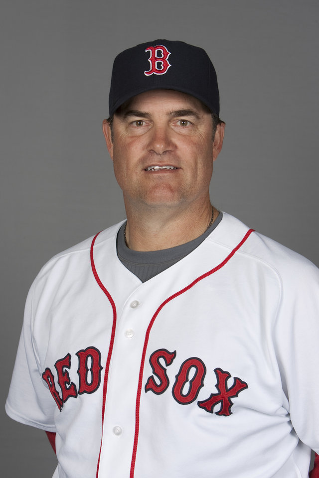Photo -   FILE - This 2010, file photo shows Boston Red Sox pitching coach John Farrell. The Red Sox are preparing to announce that John Farrell will be their new manager, according to a baseball official with knowledge of the deal to bring the former Boston pitching coach back one year after the ballclub first tried to give him the top job. The announcement was delayed by the unusual logistics of hiring a manager under contract with another team, the official said, speaking on the condition of anonymity because the final procedural steps had not been cleared. But the three-year deal to replace Bobby Valentine could be announced as soon as Sunday, Oct. 21, 2012 the official said. (AP Photo/Nati Harnik, File)