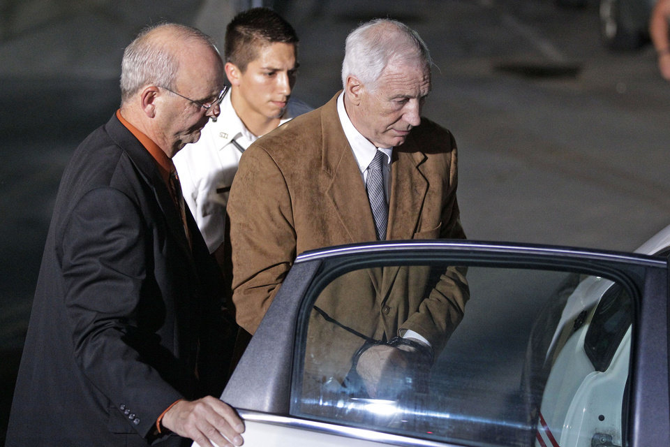 Photo -   Former Penn State University assistant football coach Jerry Sandusky, right, is escorted by Centre County Sheriff Denny Nau, left, as he is taken into custody at the Centre County Courthouse after being found guilty of multiple charges of child sexual abuse in Bellefonte, Pa., Friday, June 22, 2012. Sandusky was convicted of sexually assaulting 10 boys over 15 years on Friday, accusations that had sent shock waves through the college campus known as Happy Valley and led to the firing of Penn State's beloved Hall of Fame coach, Joe Paterno. (AP Photo/Gene J. Puskar)