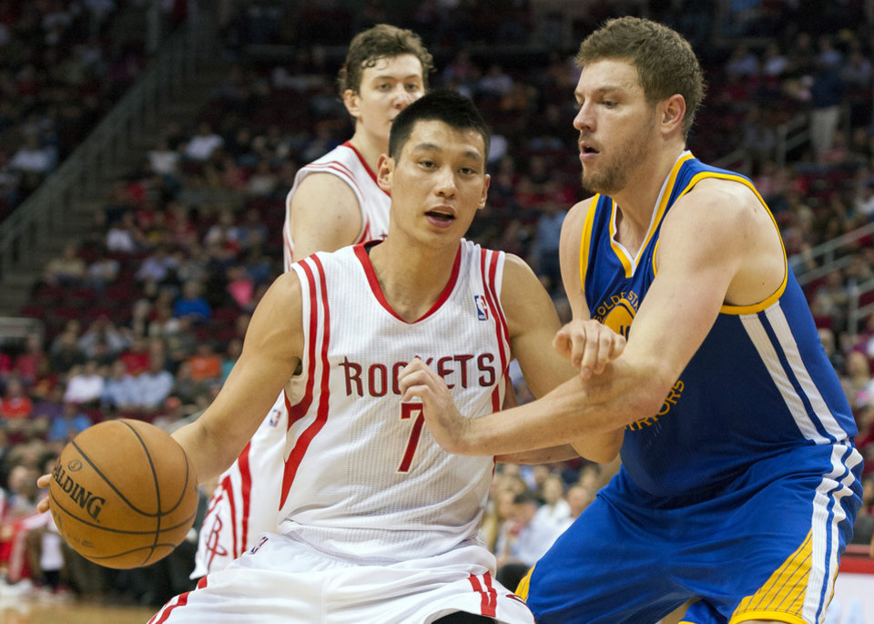 Houston Rockets\' Jeremy Lin (7) drives against Golden State Warriors\' David Lee, right, during the third quarter of an NBA basketball game, Tuesday, Feb. 5, 2013, in Houston. The Rockets beat the Warriors 140-109. (AP Photo/Dave Einsel)