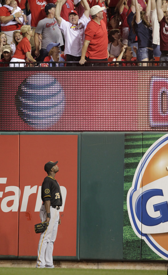 Photo - Pittsburgh Pirates right fielder Gregory Polanco (25) watches the fans react to St. Louis Cardinals' Kolten Wong's walk-off home run in the ninth inning of a baseball game, Tuesday, July 8, 2014 in St. Louis. The Cardinals beat the Pirates 5-4. (AP Photo/Tom Gannam)