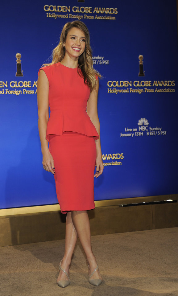 Photo - Actress Jessica Alba poses for photographers after helping to announce nominations for the 70th Annual Golden Globe Awards, Thursday, Dec. 13, 2012, in Beverly Hills, Calif. The Golden Globe Awards will be held on Sunday, Jan. 13 at the Beverly Hilton Hotel in Beverly Hills. (Photo by Chris Pizzello/Invision/AP)