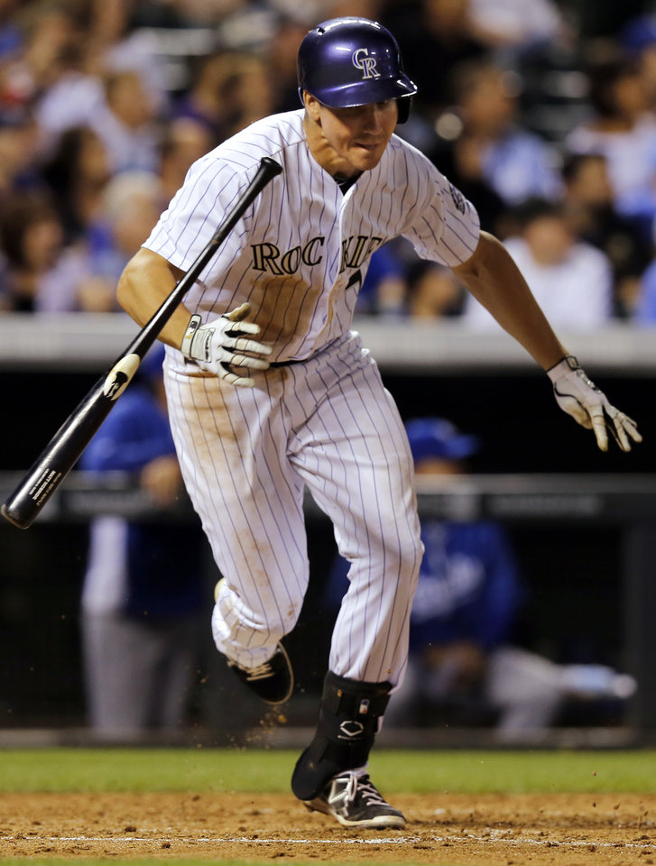 Photo - Colorado Rockies' Matt McBride runs after hitting a grand slam off Kansas City Royals starting pitcher Danny Duffy during the sixth inning of a baseball game Wednesday, Aug. 20, 2014, in Denver. (AP Photo/Jack Dempsey)