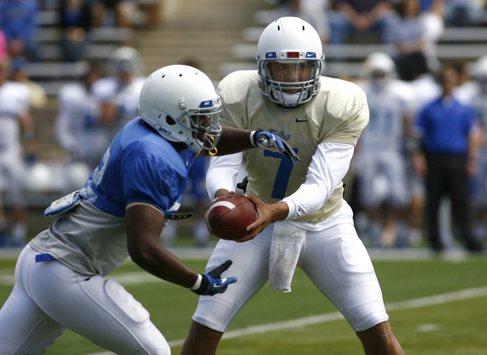 Tulsa quarterback Cody Green, right, hands off to Trey Watts at the Golden Hurricane's spring game on Saturday, April 6. PHOTO BY MATT BARNARD, TULSA WORLD