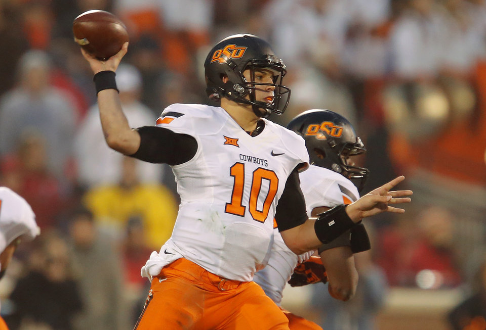 Photo - Oklahoma State's Mason Rudolph throws a pass during a Bedlam college football game between the University of Oklahoma Sooners (OU) and the Oklahoma State Cowboys (OSU) at Gaylord Family-Oklahoma Memorial Stadium in Norman, Okla., Saturday, Dec. 6, 2014. Photo by Bryan Terry, The Oklahoman