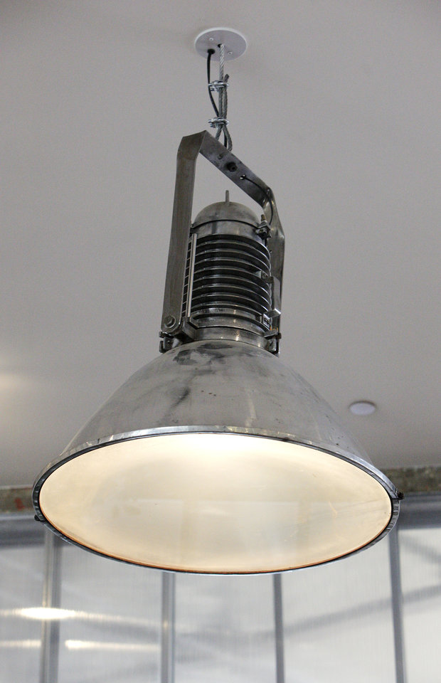 Photo -  An old ship's lantern brought over from England is used for lighting in the former Chrysler building, now branded the Monterey, at 309 NW 13 St. in Oklahoma City.  Photo by Paul B. Southerland, The Oklahoman   PAUL B. SOUTHERLAND -  PAUL B. SOUTHERLAND