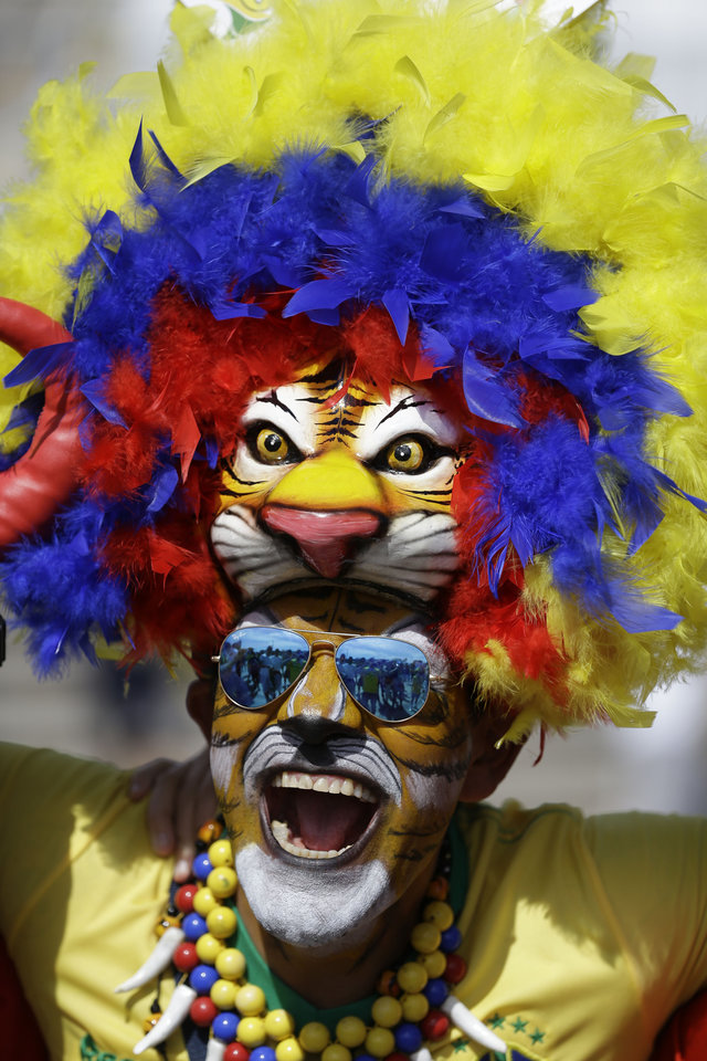 Photo - A fan cheers outside the Mineirao Stadium before the group H World Cup soccer match between Belgium and Algeria, in Belo Horizonte, Brazil, Tuesday, June 17, 2014.  (AP Photo/Sergei Grits)