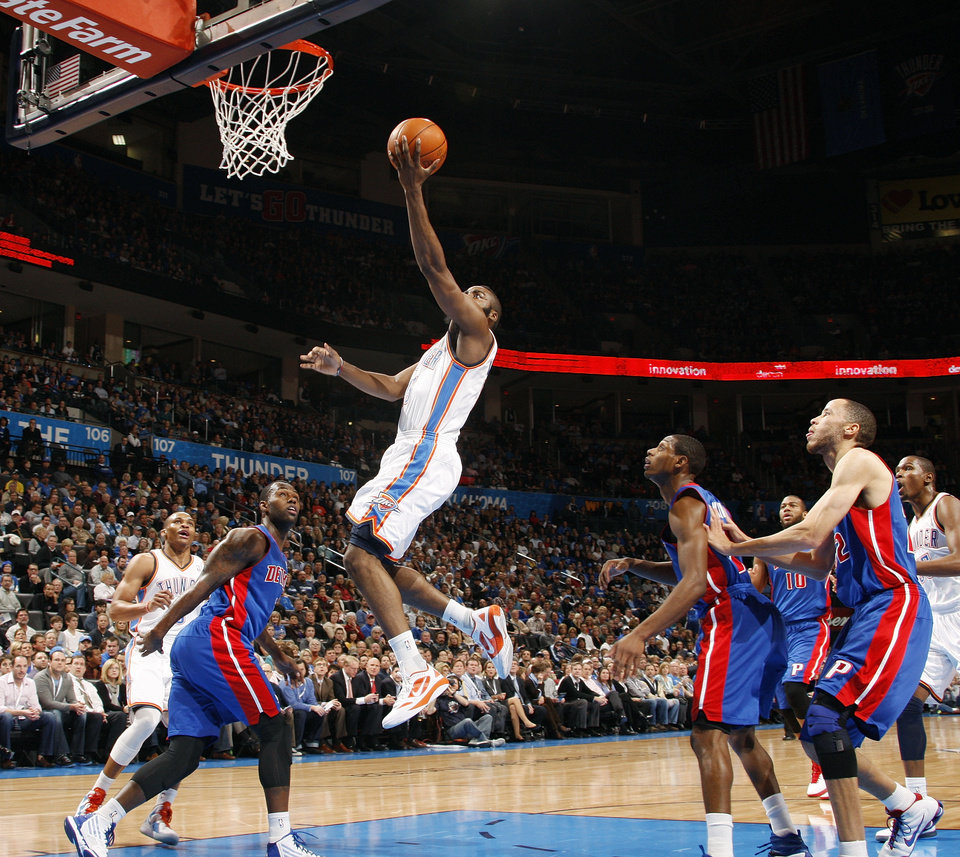 Photo - Oklahoma City's James Harden (13) takes a shot during the NBA basketball game between the Detroit Pistons and Oklahoma City Thunder at the Chesapeake Energy Arena in Oklahoma City, Monday, Jan. 23, 2012. Photo by Nate Billings, The Oklahoman