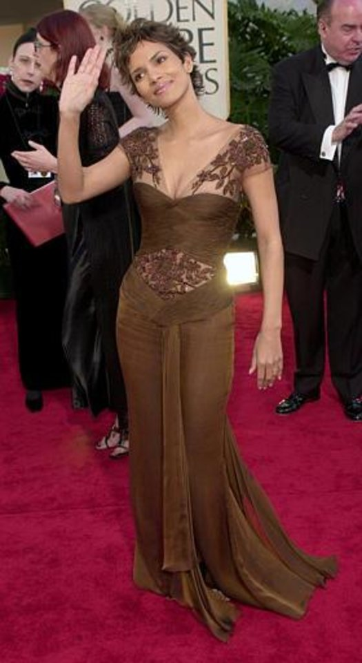 Actress Halle Berry waves as she arrives for the 59th Annual Golden Globe Awards in Beverly Hills, Calif., Sunday, Jan. 20, 2002. Berry is nominated for best performance by an actress in a motion picture drama for her work in Monsters Ball. (AP Photo/Kevork Djansezian)