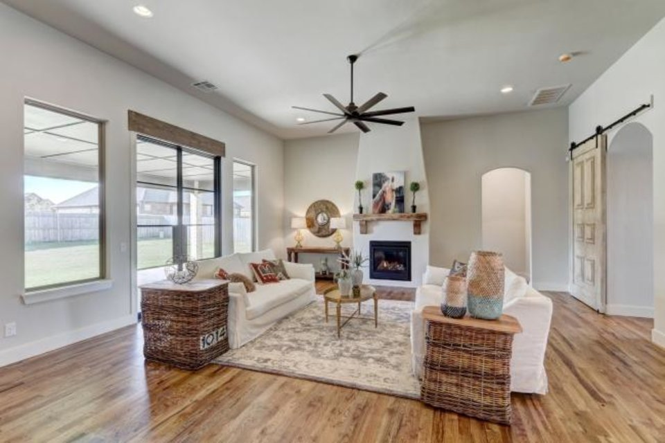 Photo -  A view of the living area at Bear Creek Homes' entry at 301 Old Home Place in Settlers Ridge addition, which won Best Overall in the $370,000-$394,999 category of the Parade of Homes Fall Classic. [CENTRAL OKLAHOMA HOME BUILDERS ASSOCIATION]