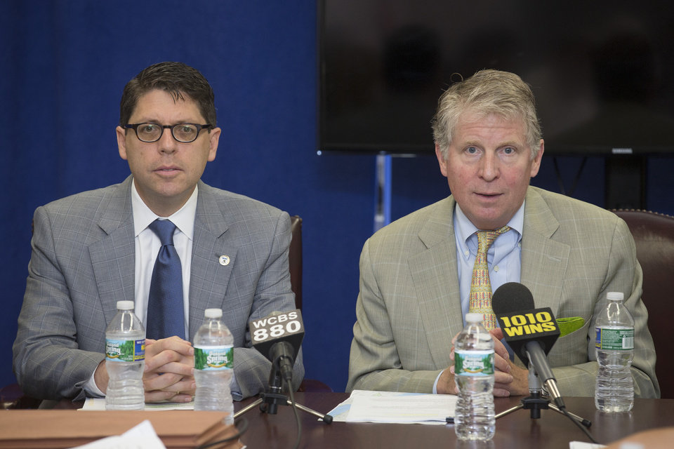 Photo - Manhattan District Attorney Cyrus Vance, right, speaks alongside New York City Department of Investigation Commissioner Mark Peters during a round table news conference with reporters at the Manhattan District Attorney's offices, Wednesday, July 2, 2014, in New York. Vance announced the indictment of several individuals and businesses on charges including grand larceny, fraud, forgery, and evidence tampering through a building site safety inspection scam. (AP Photo/John Minchillo)