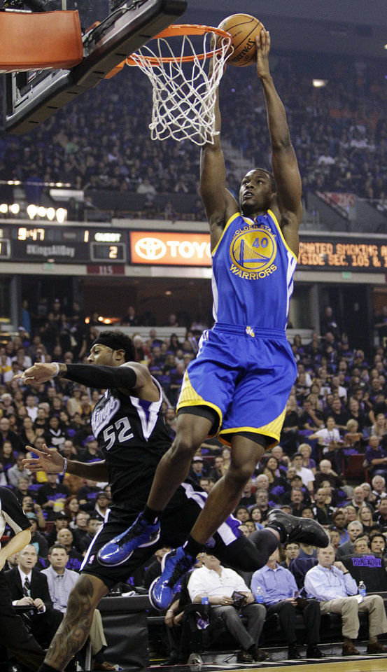 Photo -   Golden State Warriors forward Harrison Barnes (40) dunks over Sacramento Kings forward James Johnson during the first quarter of an NBA basketball game in Sacramento, Calif., Monday, Nov. 5, 2012. (AP Photo/Rich Pedroncelli)
