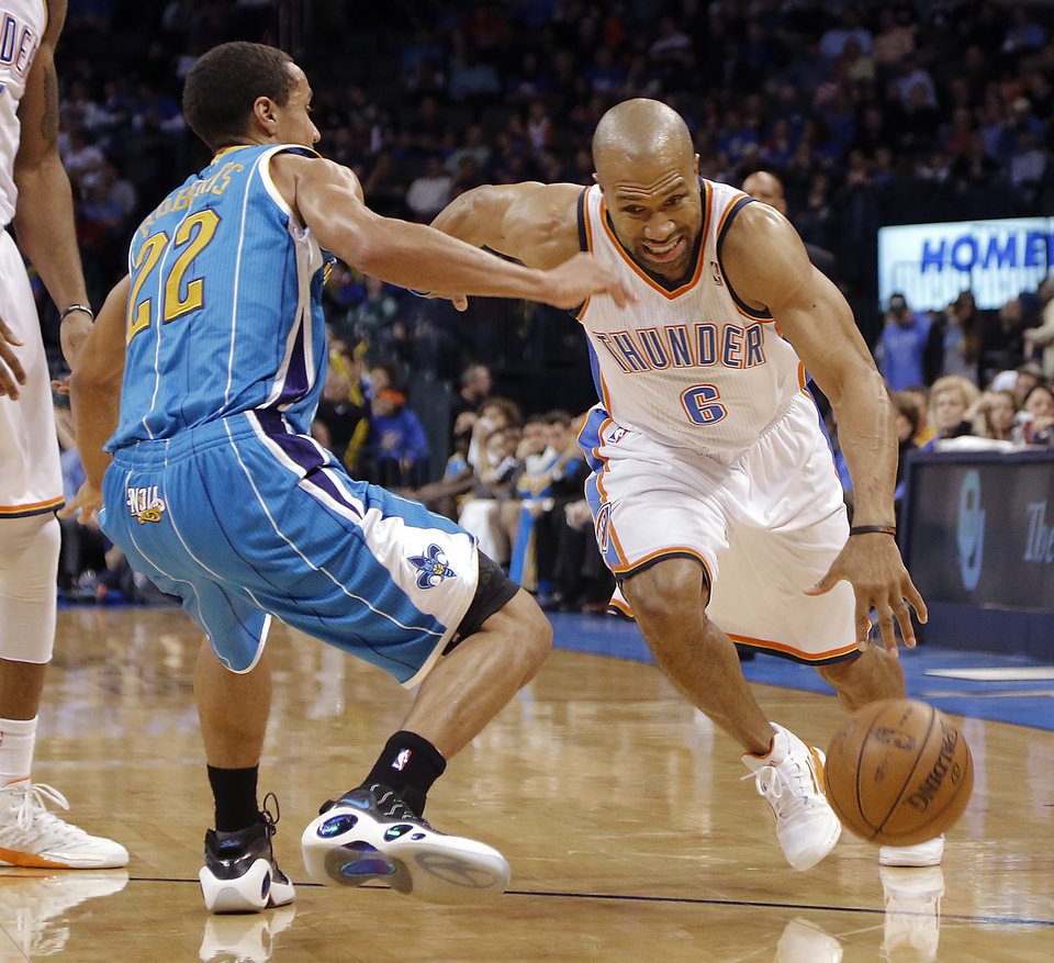 Photo - Oklahoma City Thunder's Derek Fisher (6) drives past New Orleans Hornets' Brian Roberts (22) during the NBA basketball game between the Oklahoma City Thunder and the New Orleans Hornets at the Chesapeake Energy Arena on Wednesday, Feb. 27, 2013, in Oklahoma City, Okla. Photo by Chris Landsberger, The Oklahoman