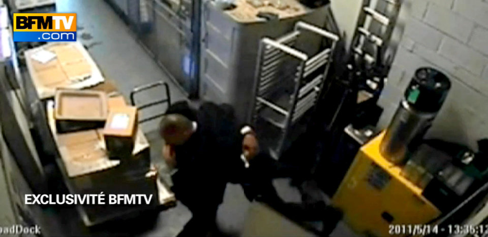 Photo -   In this image made from surveillance video obtained by France's BFM television and publicly aired for the first time Thursday, Dec. 8, 2011, two Sofitel hotel employees dance in a basement corridor of the hotel in New York on May 14, 2011. Hotel maid Nafissatou Diallo accused Dominique Strauss-Kahn of sexual assault in his room. The video is the basis of recent news reports suggesting Strauss-Kahn might have been the target of a political plot. (AP Photo)