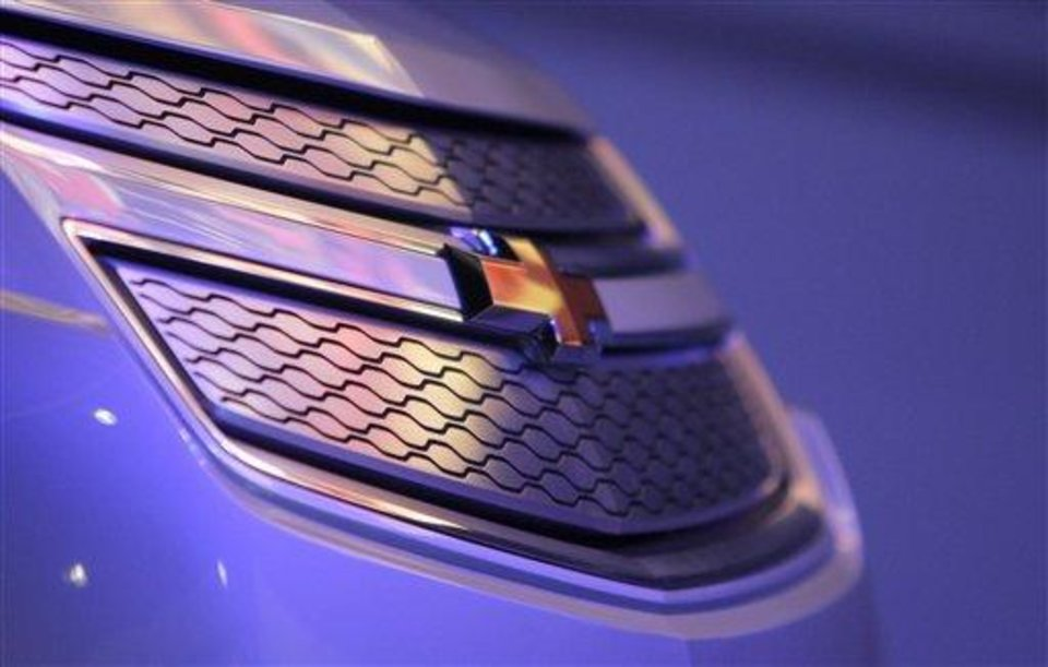 The Chevrolet logo is seen on a 2011 Chevy Volt at the Los Angeles Auto Show in Los Angeles, Wednesday, Dec. 2, 2009. (AP Photo/Jae C. Hong)