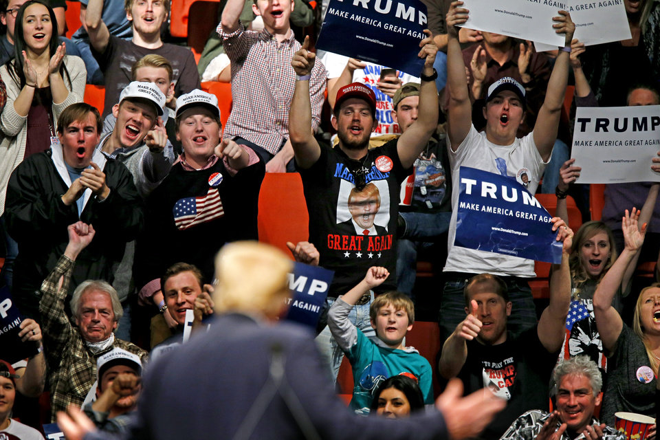Photo - The crowd reacts as Republican presidential candidate Donald Trump turns towards them during a rally at the Cox Convention Center in Oklahoma City, Friday, Feb. 26, 2016. Photo by Bryan Terry, The Oklahoman
