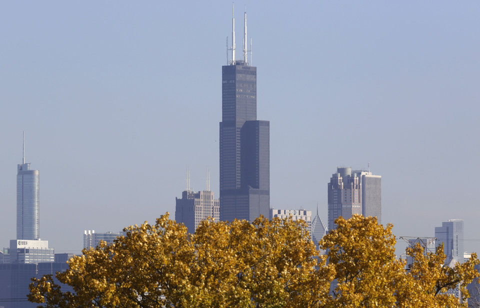 Photo - FILE - This Nov. 7, 2013, photo shows a partial view of Chicago's 110 story, 1,450 foot Willis Tower. The Tower is in contention with the 104-story, 1,776 foot One World Trade Center, a skyscraper built at the site of the 9/11 attacks on the World Trade Center in New York as the tallest building in America. A committee of architects recognized as the arbiters on world building heights is meeting Friday Nov. 8, 2013 in Chicago to decide whether a design change affecting One World Trade Center's needle disqualifies its hundreds of feet from being counted, which would deny the building the title of nation's tallest giving the title to Willis Tower. (AP Photo/M. Spencer Green)