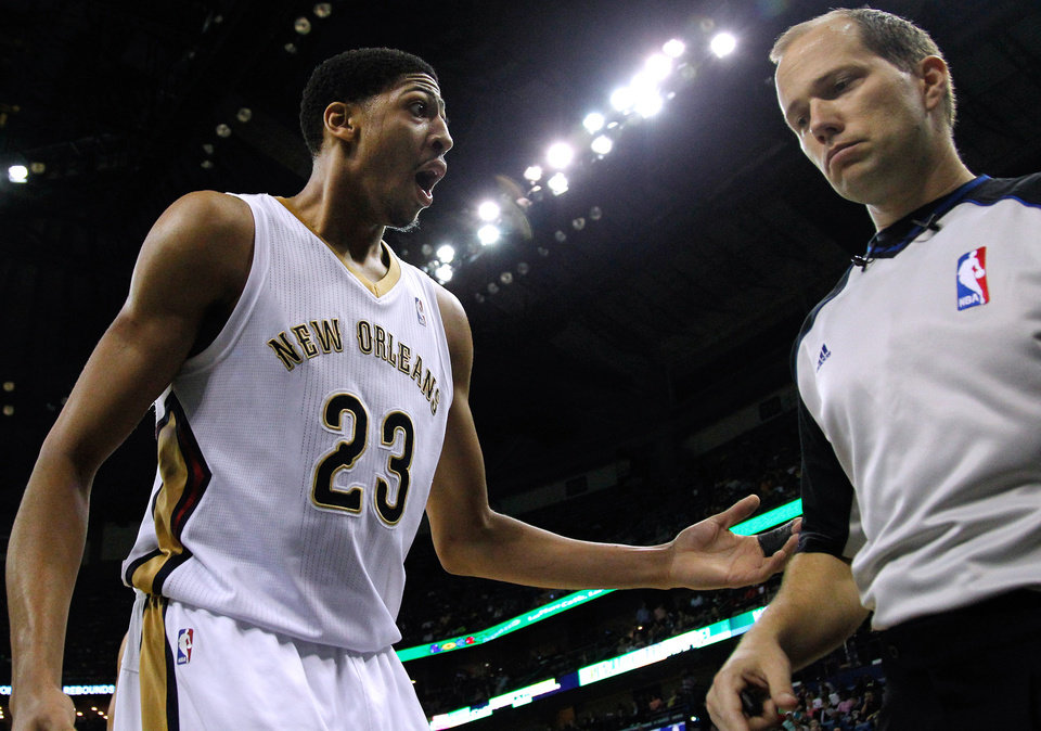 Photo - New Orleans Pelicans forward Anthony Davis (23) talks to an official during the first half of an NBA basketball game against the Boston Celtics in New Orleans, Sunday, March 16, 2014. (AP Photo/Jonathan Bachman)