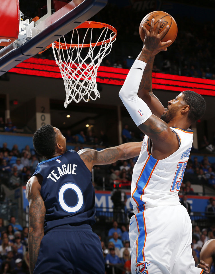 Photo - Oklahoma City's Paul George (13) shoots against Minnesota's Jeff Teague (0) during an NBA basketball game between the Oklahoma City Thunder and the Minnesota Timberwolves at Chesapeake Energy Arena in Oklahoma City, Sunday, Oct. 22, 2017. Photo by Nate Billings, The Oklahoman