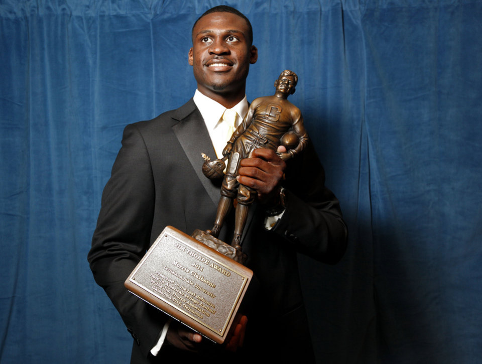 LSU\'s Morris Claiborne poses with the Jim Thorpe award before the Jim Thorpe Awards at the National Cowboy & Western Heritage in Oklahoma City, Tuesday, Feb. 7, 2012. Photo by Sarah Phipps, The Oklahoman