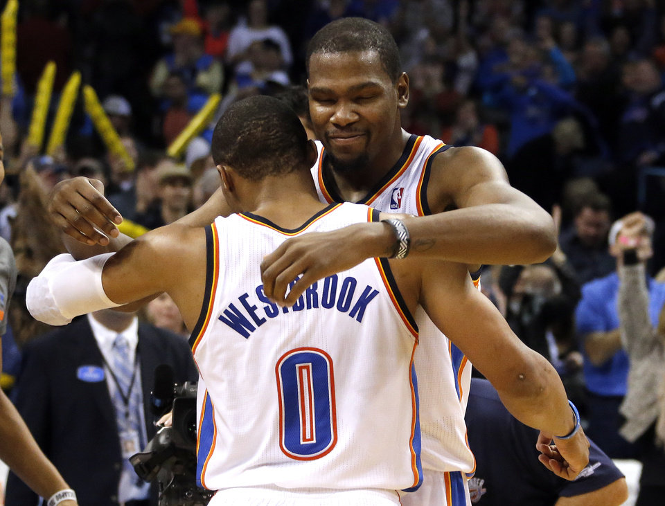 Photo - Oklahoma City's Kevin Durant (35) celebrates with Russell Westbrook (0) following the Thunder's overtime win the NBA game between the Oklahoma City Thunder and the Golden State Warriors at the Chesapeake Energy Arena, Friday, Nov. 29, 2013. Photo by Sarah Phipps, The Oklahoman