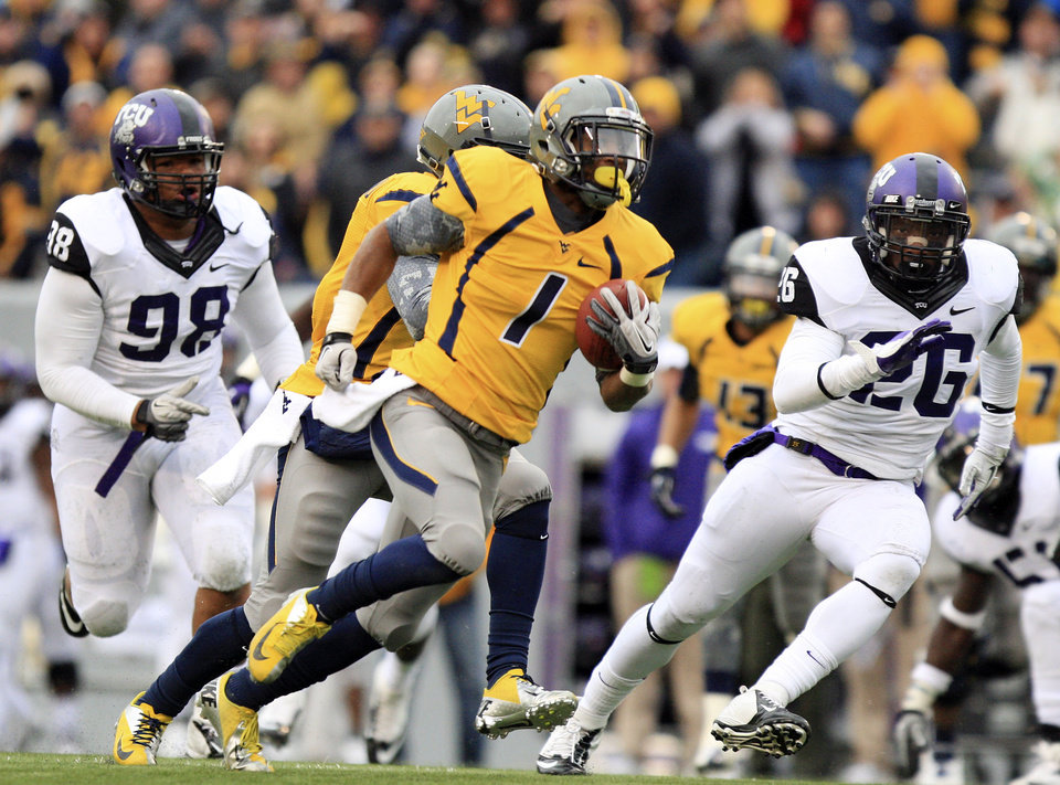 Photo -   West Virginia receiver Tavon Austin (1) carries the ball for a touchdown during the first half of their NCAA college football game against TCU in Morgantown, W.Va., on Saturday, Nov. 3, 2012. (AP Photo/Christopher Jackson)