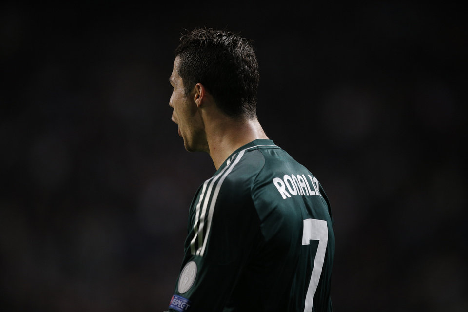 Photo -   Real Madrid player Cristiano Ronaldo screams after scoring the final goal during the Champions League Group D soccer match against Ajax at ArenA stadium in Amsterdam, Netherlands, Wednesday Oct. 3, 2012. (AP Photo/Peter Dejong)