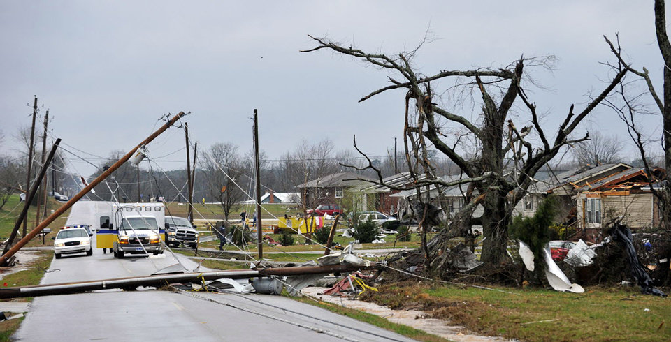 Photo -   Downed power lines and debris caused by a reported tornado lie along Yarbrough Road, Friday, March 2, 2012, in Harvest, Ala. (AP Photo/The Huntsville Times, Bob Gathany)