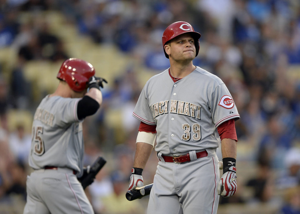 Photo - Cincinnati Reds Devin Mesoraco reacts after striking out in the eighth inning of a baseball game against the Los Angeles Dodgers, Monday, May 26, 2014, in Los Angeles. The Dodgers won 4-3. (AP Photo/Gus Ruelas)