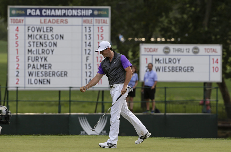 Photo - Rory McIlroy, of Northern Ireland, celebrates a putt on the 13th hole during the final round of the PGA Championship golf tournament at Valhalla Golf Club on Sunday, Aug. 10, 2014, in Louisville, Ky. (AP Photo/Jeff Roberson)